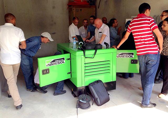 Ing. Hakan Ericsson sending programmes from laptop to control panel of a generator set